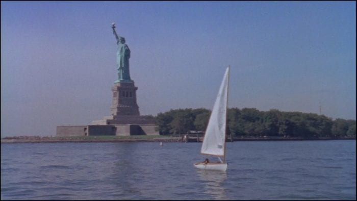 Still from Me the Terrible. A small sail boat sails in front of the Statue of Liberty in New York Harbor. Short added to the Criterion Channel May 2021