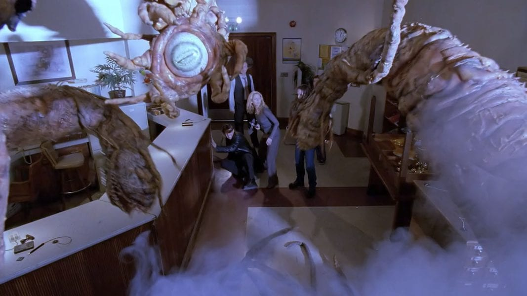 From the POV of a giant tentacled demon in Sunnydale High library, with Buffy, Angel, Faith, and Giles facing it