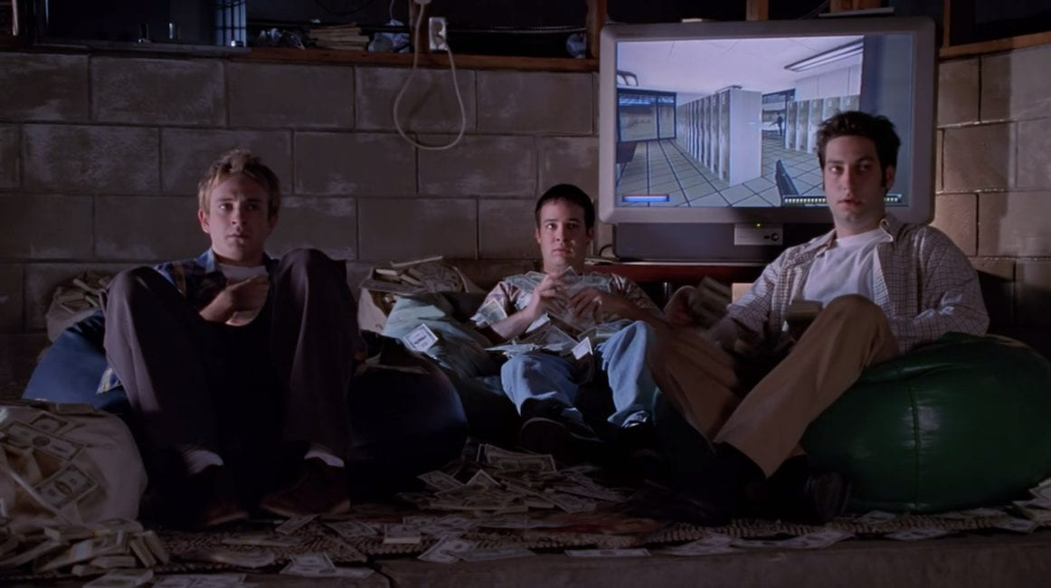 The Trio (Andrew, Jonathan, and Warren) sat on beanbags in their 'lair', looking confused