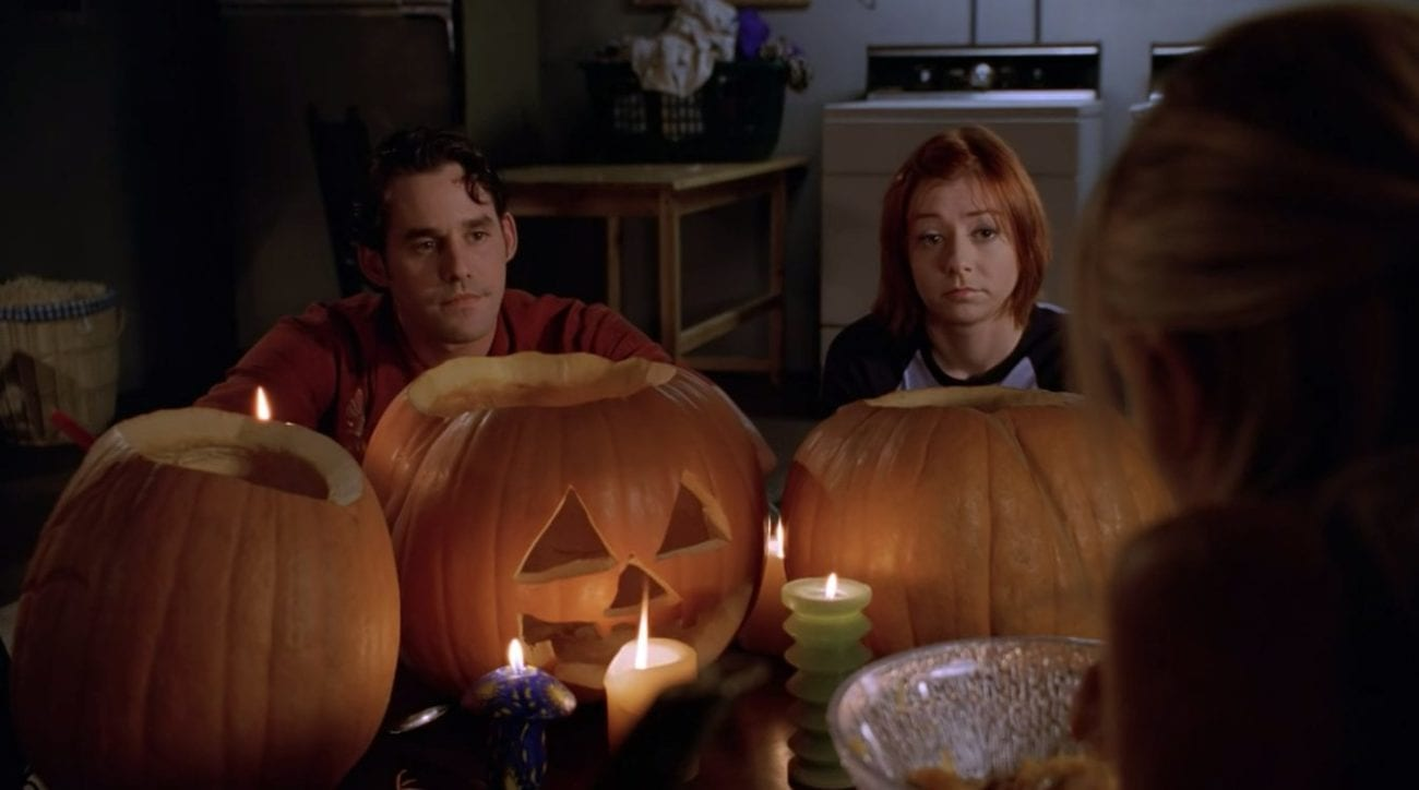 Xander and Willow sat with some pumpkins they've carved (over the shoulder shot from Buffy's POV)