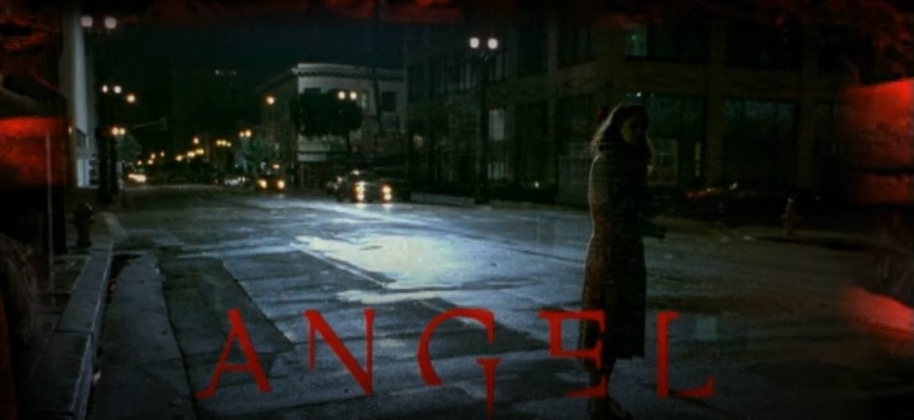 A woman stands on a street as the title of Angel appears on the bottom of the screen