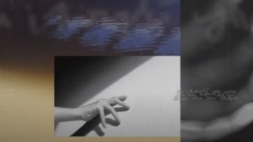 A hand reaches towards a white square, juxtaposed with images of water in the background in Anrimeal's video for Elegy for an Empty Ocean (The Silver Field Mix)
