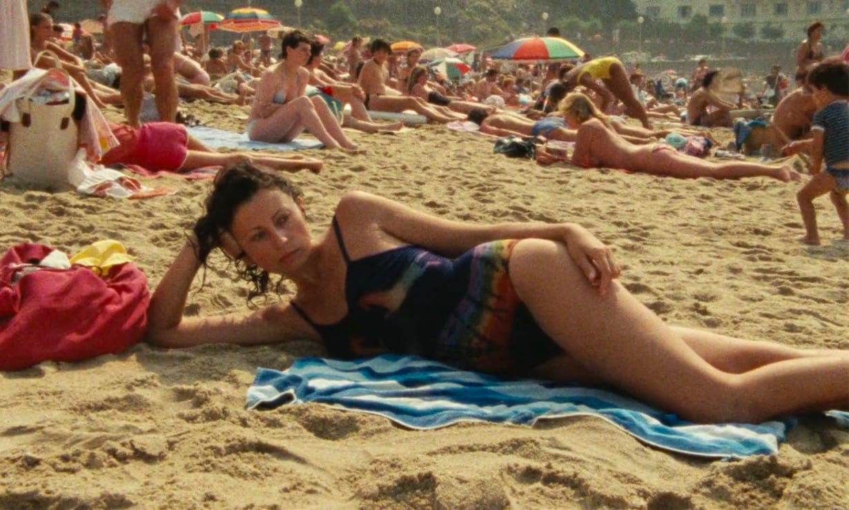 Delphine lying on her side at the beach in Biarritz.