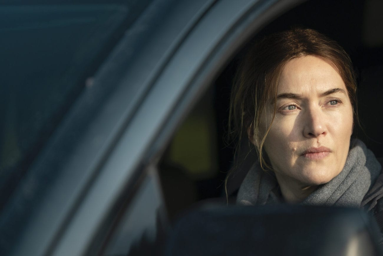 Mare (Kate Winslet) sits in her car.