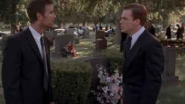 Nate and David face off standing in a cemetery