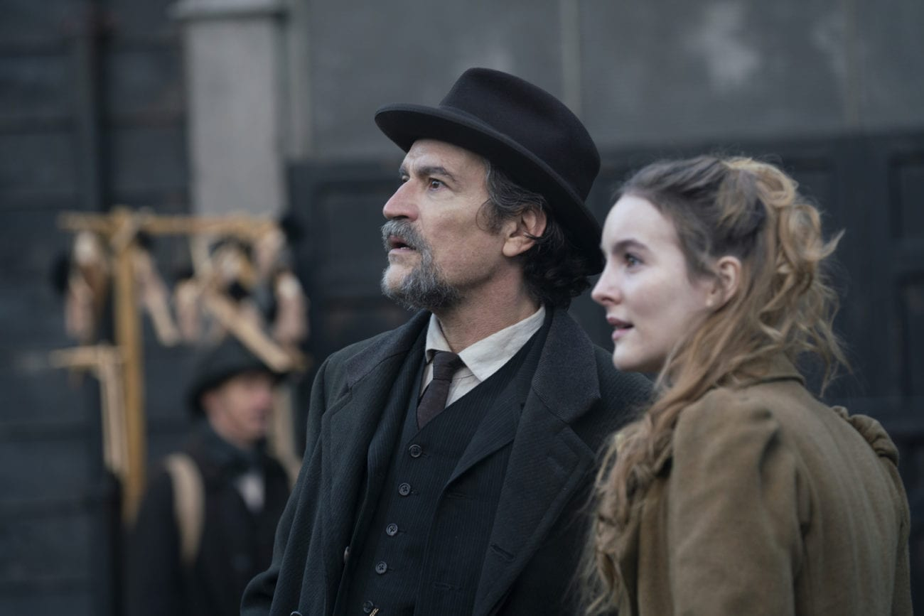 """Frank and Penance looking on as they stand in a crowd in The Nevers S1E5 """"Hanged"""""""