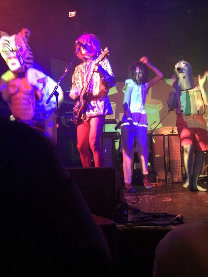 of Montreal onstage dressed in wild costumes