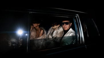 Halston looking out the rolled-down window of his limousine
