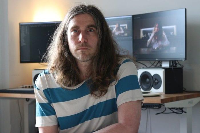 Editor Jon Philpot sits at his editing work station