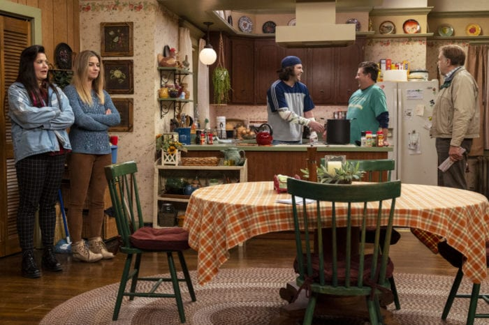 Allison and Patty look towards to Kevin and Neil as they make chili in the sitcom kitchen set, while Pete looks on from across the room.