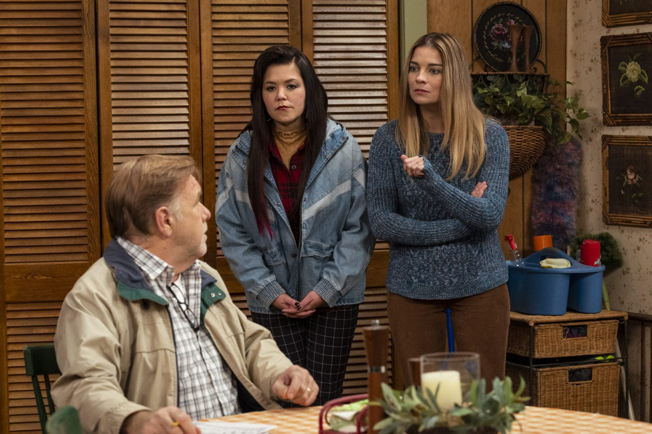 Patty and Allison look disapprovingly at Pete in the sitcom kitchen set.