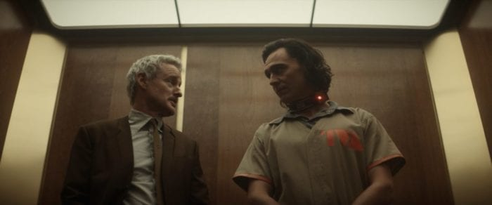 Agent Mobius and Loki discuss time travel in an elevator.