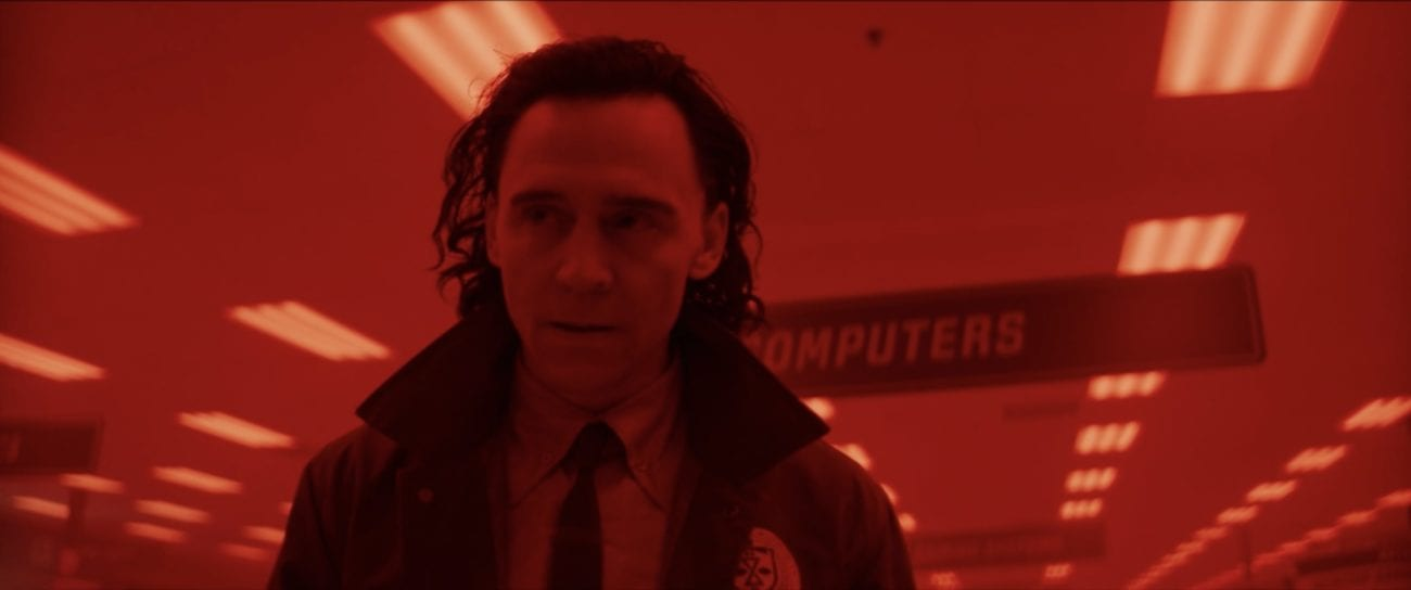 Loki decides to run away with his fellow variant, bathed in red light.