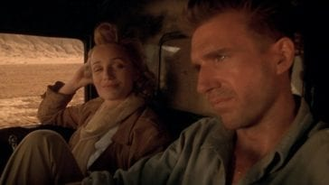 Almasy and Katharine on a Saharan Safari, in a jeep driving next to each other