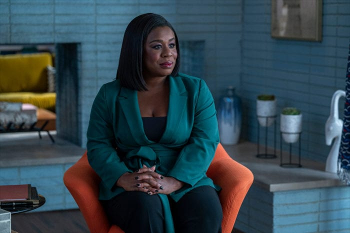 Uzo Aduba sits in a chair as the new doctor