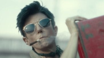 Tig Notaro in sunglasses with a cigar in her mouth in Army of the Dead