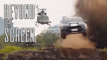 A car speeds down a road with a helocopter behind it in Fast and Furious 9, with the words Beyond the Screen superimposed on the image