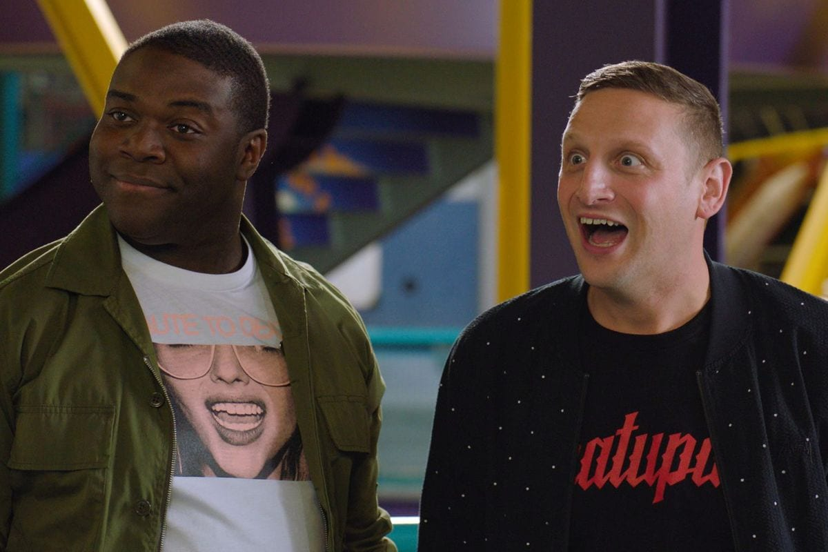 Sam and Tim stand next to each other in Detroiters