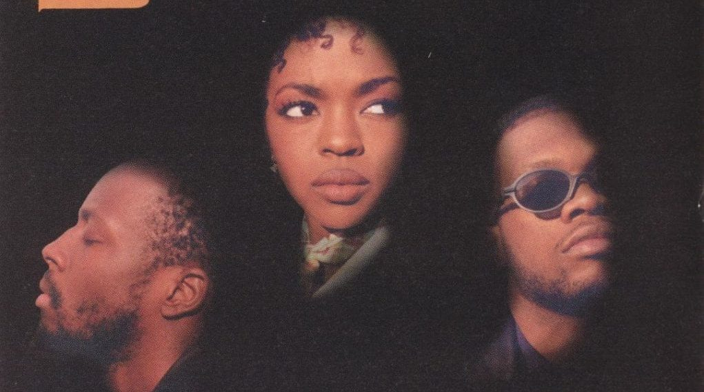 The Fugees against a black background on the cover of The Score