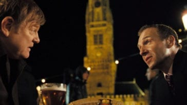 Ken is confronted by Harry in the Bruges town square after defying his order to kill Ray.