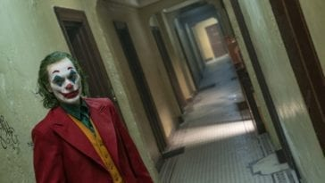 The Joker walks down a twisted hallway