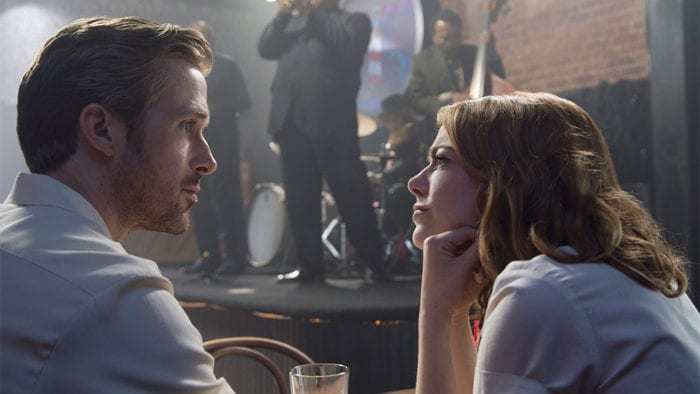 Emma Stone looks lovingly at Ryan Gosling in a jazz club