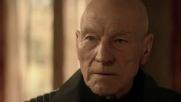 Jean-Luc Picard looks on
