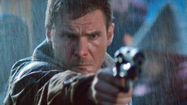 Deckard points a gun towards a target in the rain.