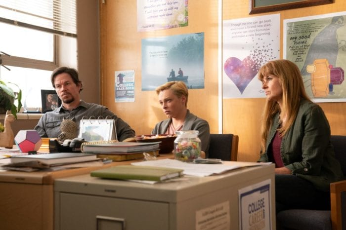 The Bell family sits in a conference in a principal's office.
