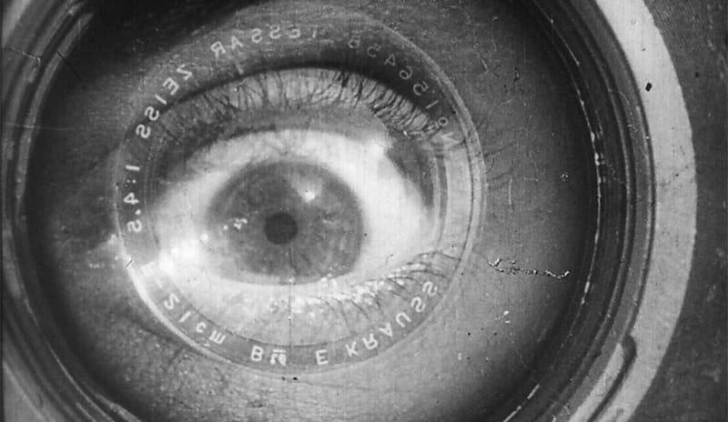 An image from Man with a Movie Camera depicts a close-up of a human eye superimposed with a camera lens.