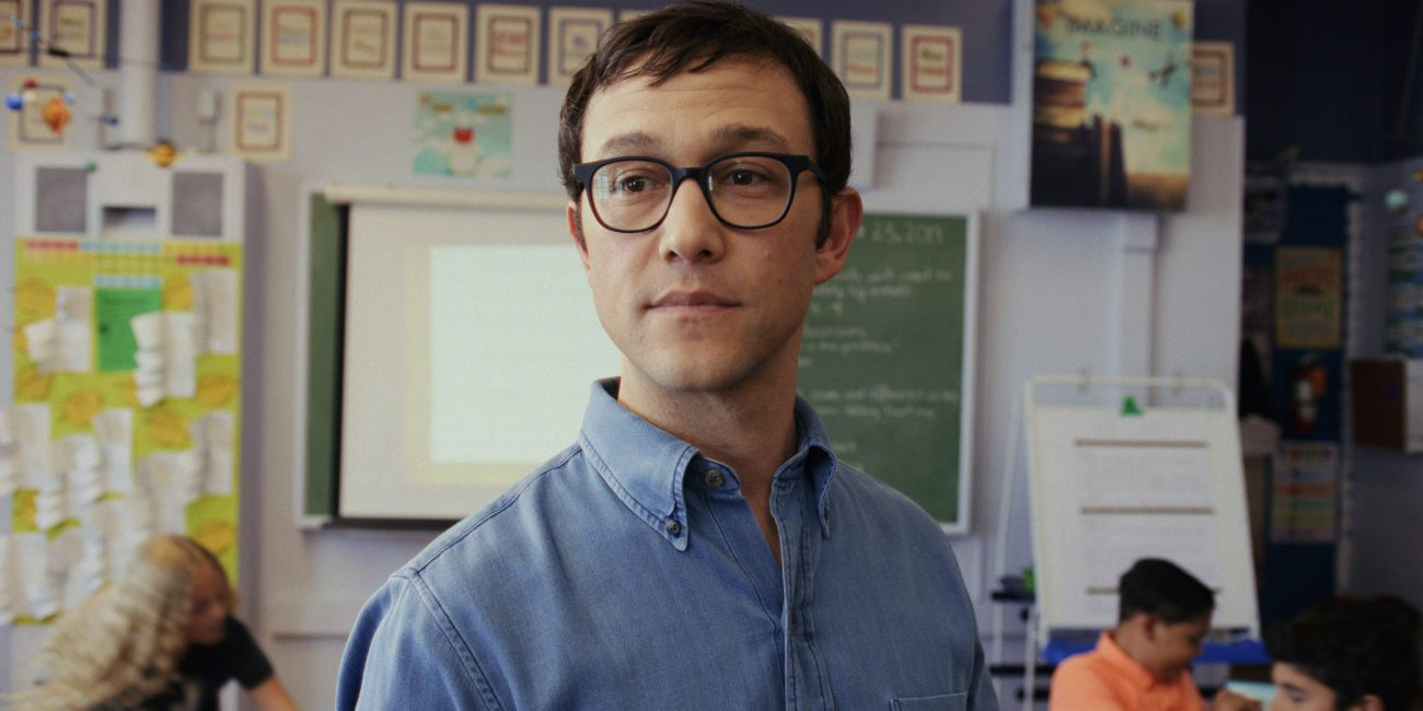 Mr. Corman stands in his classroom, looking on