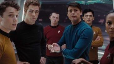 The crew of the starship Enterprise converse on the bridge.