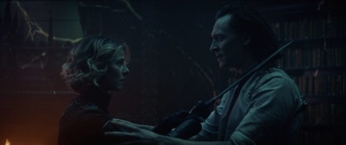 Sylvie (left) holds up her sword to Loki's (right) neck.