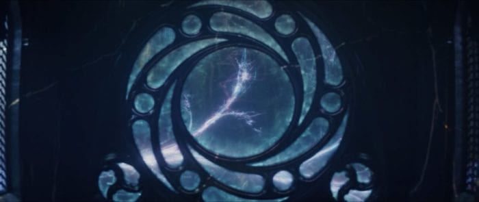 The Sacred Timeline splits into the multiverse through a circular window.