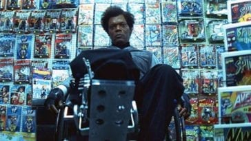 A wheel-chair bound Elijah Price (Samuel L. Jackson) sits in a comic book shop staring blankly.