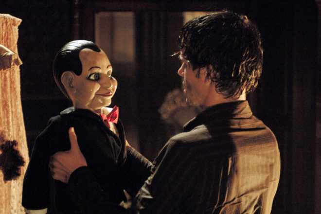 Jamie Ashen (Ryan Kwanten) stares at a ventriloquist dummy he believes might be possessed by an evil spirit.