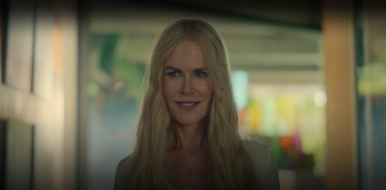 Nicole Kidman, as Masha Dmitrichenko, stands in a sunlit hallway wearing an enigmatic smile.