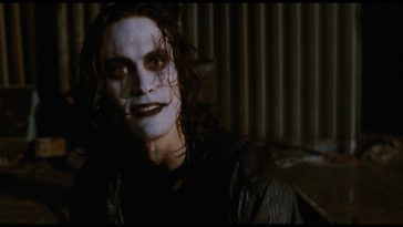 Eric Draven looks over to a friend while wearing facepaint.