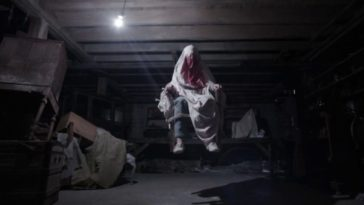 Possessed by a demon in her home, Carolyn Perron (Lili Taylor) begins floating in air during an exorcism.