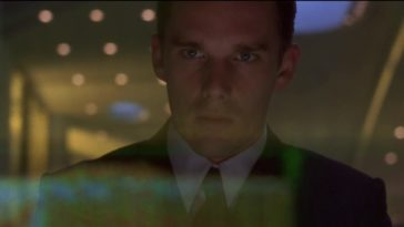 In this image from Gattaca, the character Vincent Freeman (Ethan Hawke) is depicted gazing at a computer terminal screen.