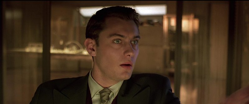 In this image from Gattaca, the character Jerome Morrow (played by Jude Law) is depicted in close-up gazing to the right.