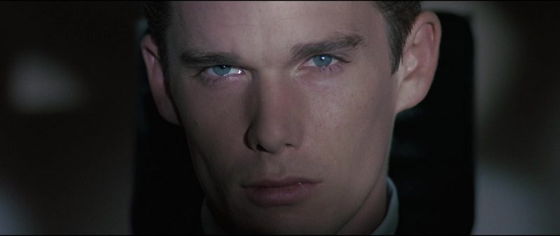 In this image from Gattaca, the character Vincent Freeman (Ethan Hawke) is depicted gazing directly at the camera in close-up.