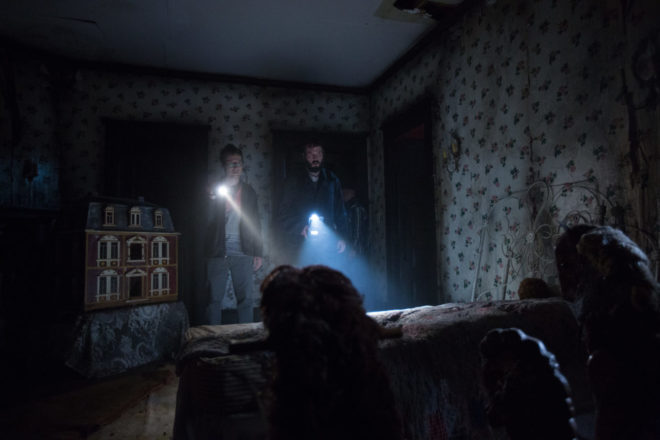 Ghost hunters Specs (Leigh Whannell) and Tucker (Angus Sampson) investigate a room of a house that is potentially haunted my an evil spirit.