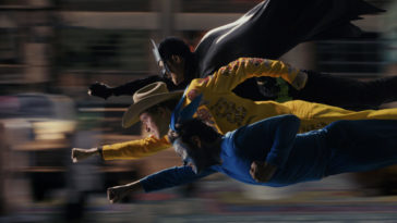 Josh, Dax and Victor fly through the air, punching, in a cartoonish style in Mr. Corman Action Adventure