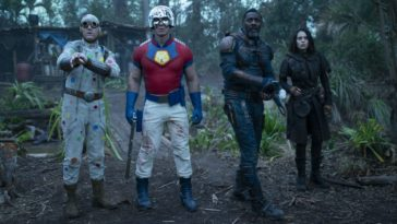 Polka Dot Man, Peacemaker, Bloodsport, and Ratcatcher 2 stare across from their adversaries in a forest.