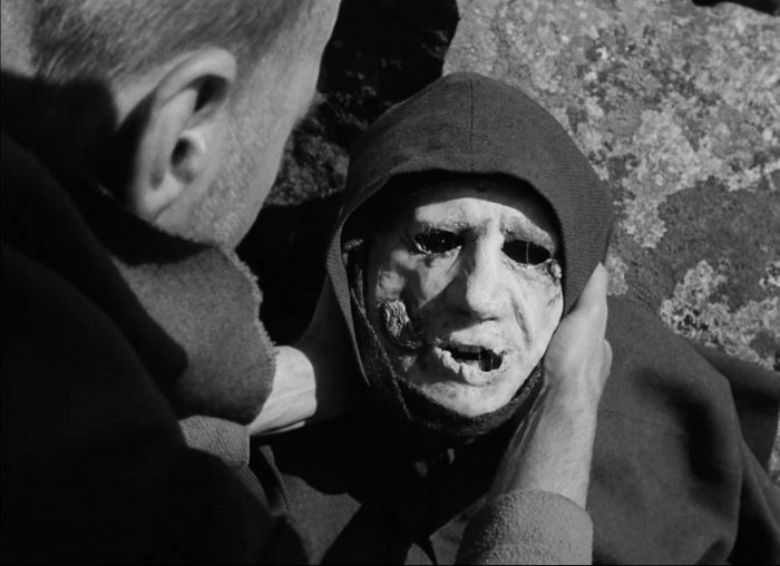 In this image from The Seventh Seal, Jons (played by Gunnar Björnstrand) is depicted holding a plague victim's corpse.