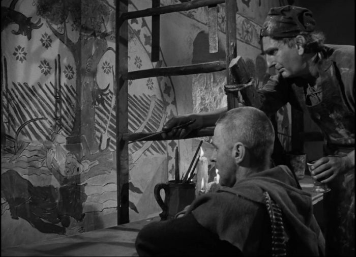 In this image from The Seventh Seal, the Albertus Pictor, the church painter (Gunnar Olsson) and the Squire Jons (Gunnar Björnstrand) observe a mural depicting the victims of the Black Death's victims.