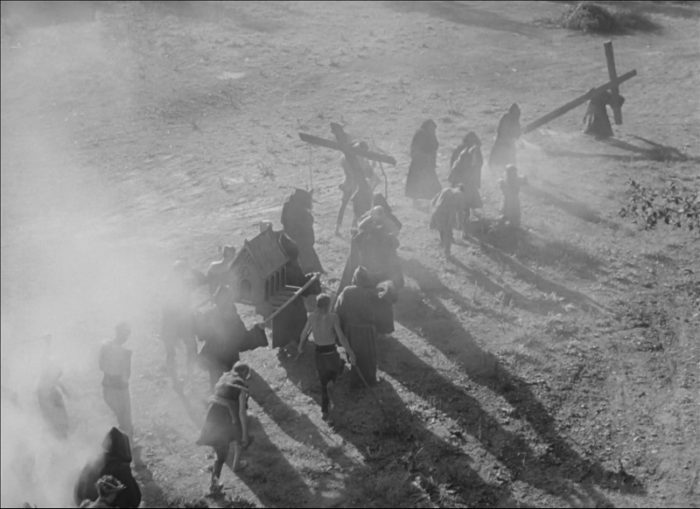 In this image from The Seventh Seal, a procession of flagellants is depicted in a long shot from a high angle.