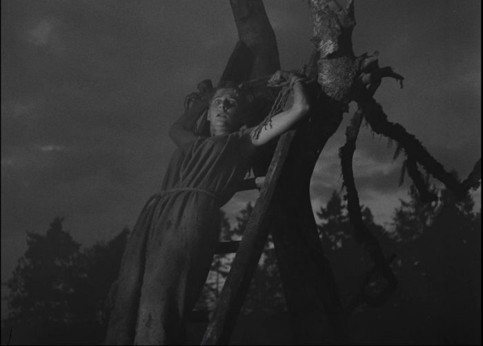 In this image from The Seventh Seal, a suspected witch (Maud Hansson) is depicted being burned on a pyre.