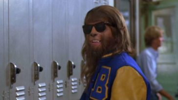 Scott, as the wolf, in a letterman jacket and sunglasses
